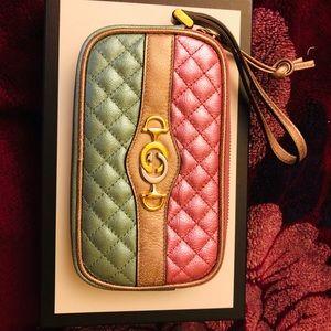 New in box Gucci metallic wristlet